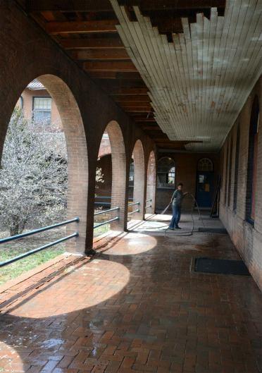Hosing down the brick walkway