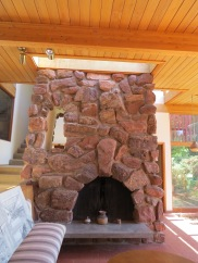 Red sandstone that was mined in Golden, N.M. is a prominent feature both in the interior and exterior of the home