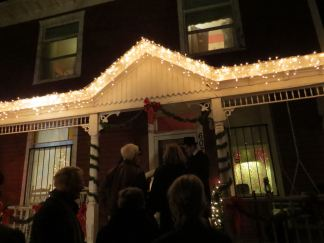 Tour participants learn more about the home at 602 Arno St before enjoying dinner.