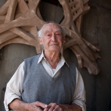 Paolo Soleri, architect, in front of one of his designs for an airport. Arcosanti, Arizona.