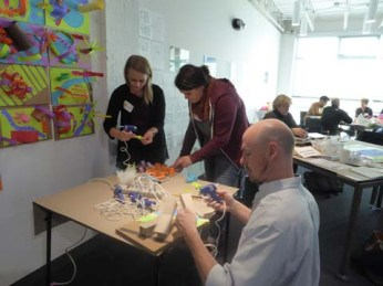 Teachers in training at the glue station