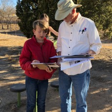 Joel Wooldridge, a retired CABQ planner, helps a student plan his project
