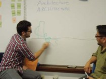 John Florez and Xavier Obando show students how architecture interacts with the local community