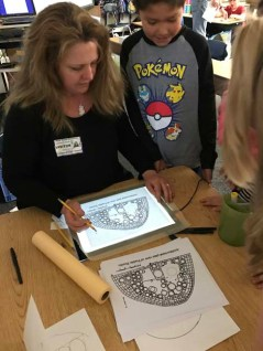 Sophie Brasfield gives students a drawing demonstration