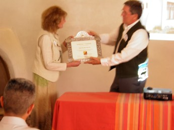Cindy Atkins accepts the award for the Fechin House