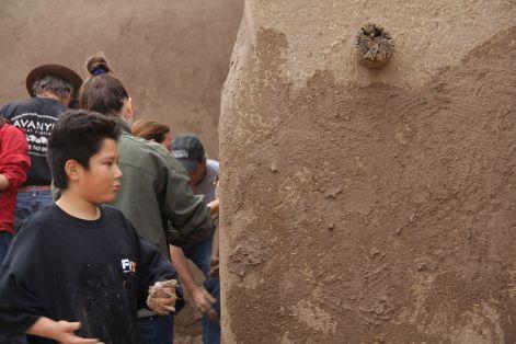 Community members and friends mud plastering, 2012. Tania Hammidi, photographer.