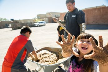 Community members mud plastering, 2014. Minesh Bacrania Photography.