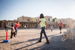 Children playing in Bupingeh, the main plaza, looking south, 2014. Minesh Bacrania Photography.