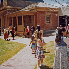 "Participants at a ""Kids and Toys Tea Party"" in the Museum courtyard, early 1990s (Photo courtesy of the Silver City Museum)."