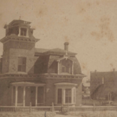 The Ailman (left) and Meredith houses on Broadway, Silver City, soon after their construction in 1881. In 1905 the Meredith house was disassembled and reconstructed a few blocks away on Cooper Street; it was remodeled beyond recognition in the early 1940s. (Photo from H. B. Ailman's scrapbook, image #07724, Silver City Museum)